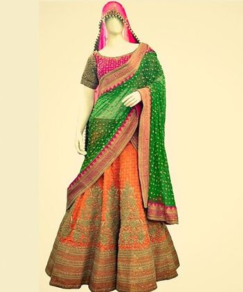 Photo of orange and green bridal lehenga
