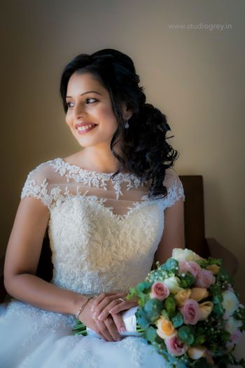 Bride posing in a beautiful white gown on her wedding day