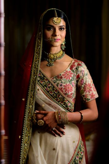 Indian bride wearing floral lehenga with minimal jewellery for wedding