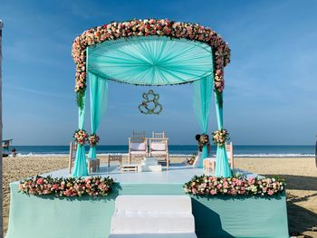 Beachside mandap in turquoise, pink and white hues.