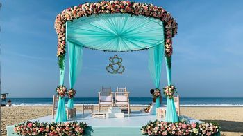 Photo of Beachside mandap in turquoise, pink and white hues.