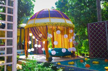 Colourful mandap with hanging lantern curtains
