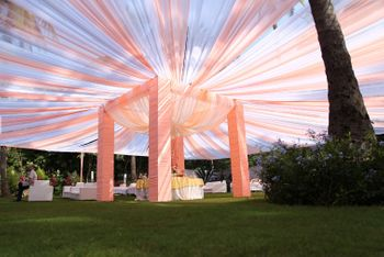 Pastel peach mandap with fabric tent