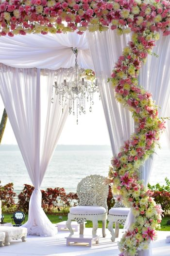 White and Pink Floral Decor with Chandeliers