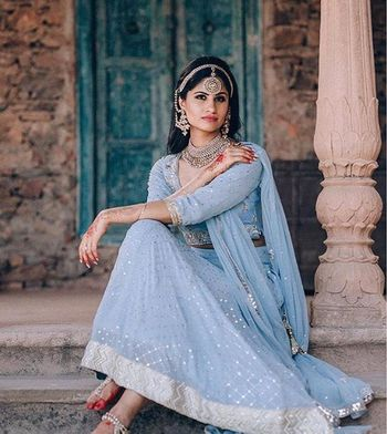 Engagement look with light blue lehenga and chunky silver jewellery