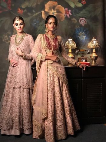 Modern bridal pastel outfit with contrasting maroon jewellery