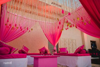 Photo of Wedding decor in bright pink with hanging floral strings