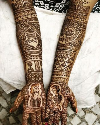 Photo of Modern Rajasthani mehendi with portraits