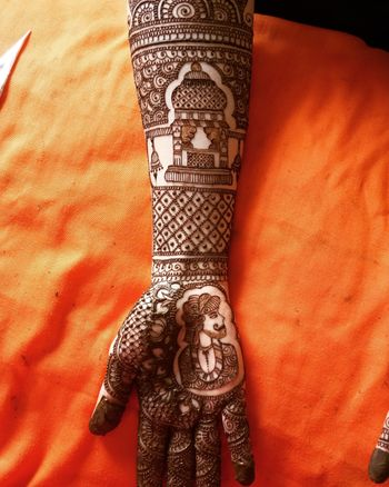 Traditional mehendi design with a twist for bride