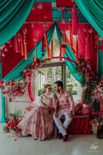 Photo of matching bride and groom with funky mehendi decor