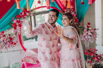 Photo of happy couple shot on mehendi with cute decor