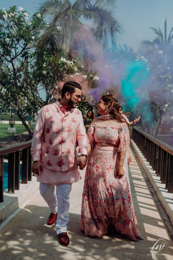 Photo of guests entering with smoke sticks on mehendi