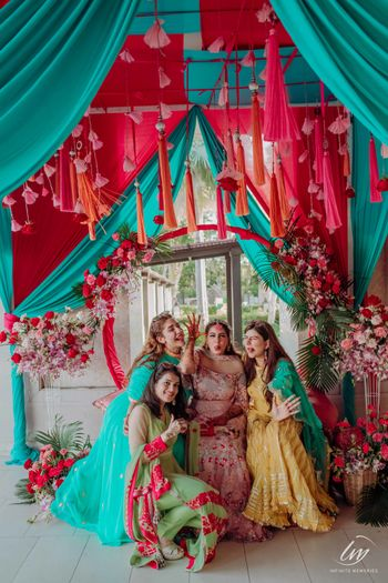 bride with bridesmaids on mehendi with tassel decor