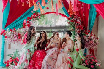 Photo of mismatched bride and bridesmaids photo