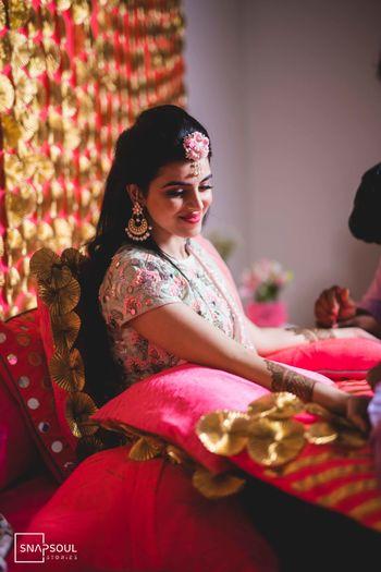Bride on mehendi getting it put