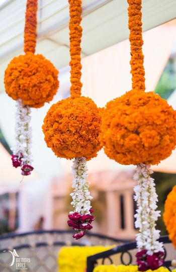 Suspended Genda Phool Balls with Floral Strings