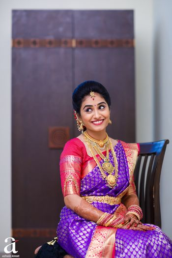South Indian bridal look with red and purple kanjivaram