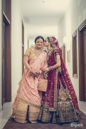 Mother Daughter Portrait with Bride in Wine Lehenga