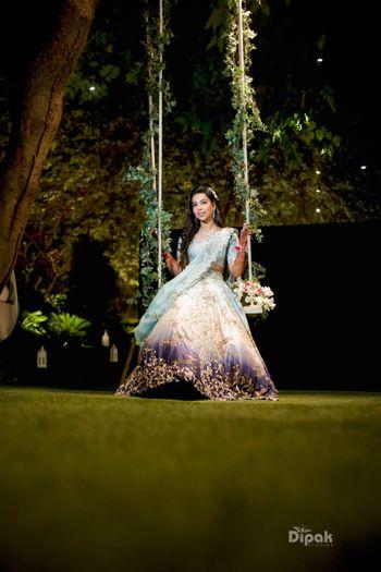 Bride on swing with leaves mehendi