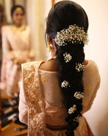 bridal mehendi hairstyle with babys breath braid