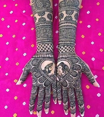 Unique half and half mehendi design with bride and groom portrait