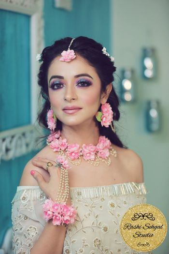 Pink floral jewellery with white outfit