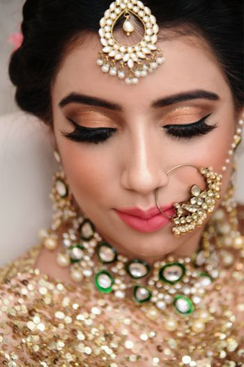 Photo of Pretty bridal portrait with gold dewy makeup