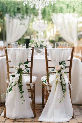 Simple yet stunning white floral chair decor