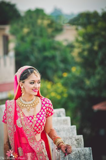Bride in pink with traditional gold jewellery