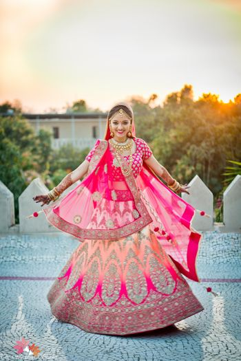 Ombre bridal lehenga in peach and bright pink