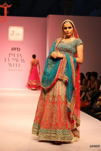 Photo of Blue and red bridal lehenga on ramp