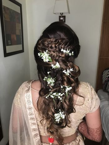 Baby breath in bridal hair braids