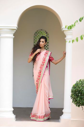 Photo of blush and red saree