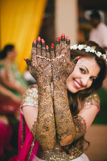 Bride showing off traditional bridal mehendi
