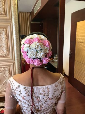 Stunning bridal hairstyle with white and pink roses