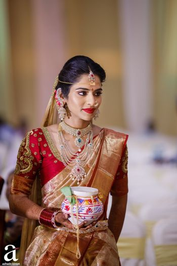 south indian bride in red and gold kanjivaram and diamond jewellery