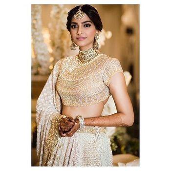 Gold Bridal Lehenga Photo happy bride shot