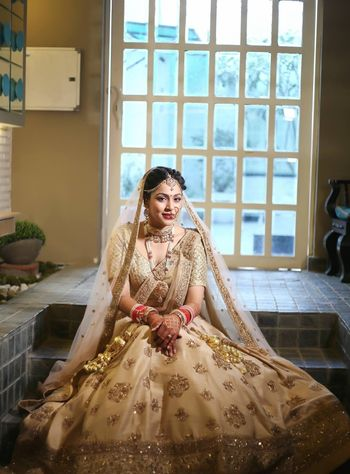 Single toned gold bridal lehenga with double dupatta drape