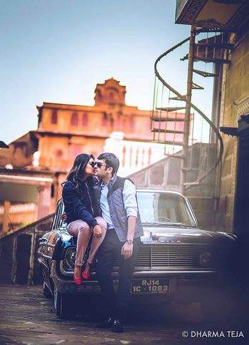 Photo of couple on a car
