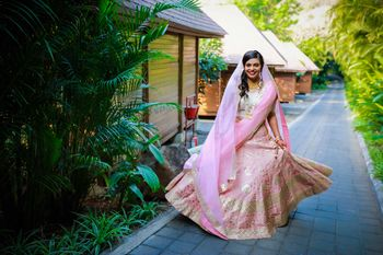 wedding day bridal shot in light pink lehenga