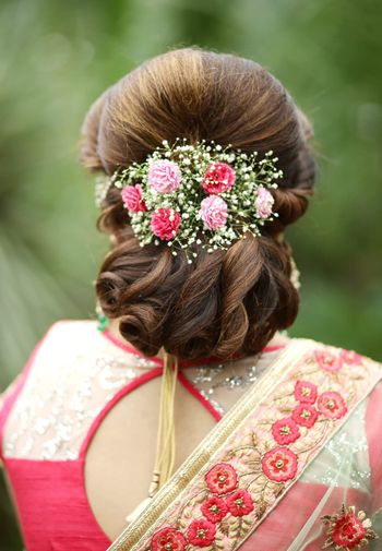 Photo of Bridal bun with babys breath and flowers