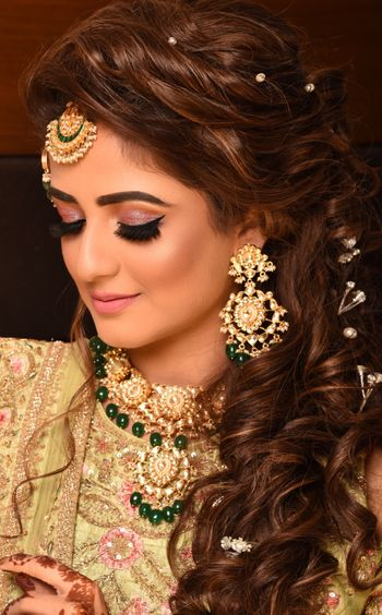 Sangeet or engagement hairstyle with pearls in hair