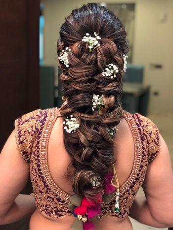 Photo of braided mehendi hairdo idea with babys breath