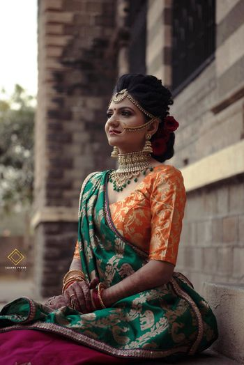 Stunning bride with orange and green outfit