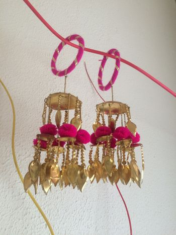Bright pink and gold kaleere with pompoms