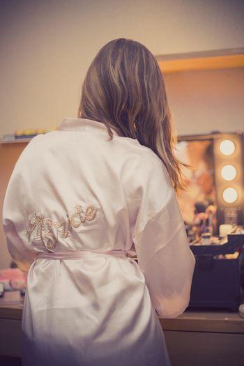 Bride getting ready shot wearing white robe
