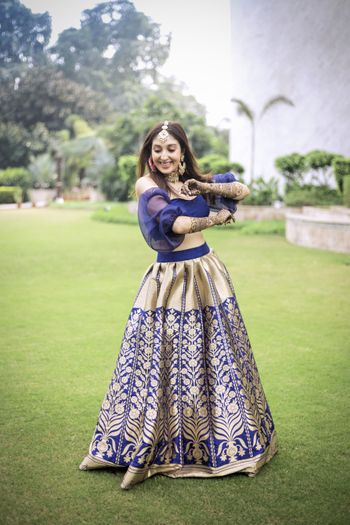 Unique blouse design with blue and gold brocade lehenga