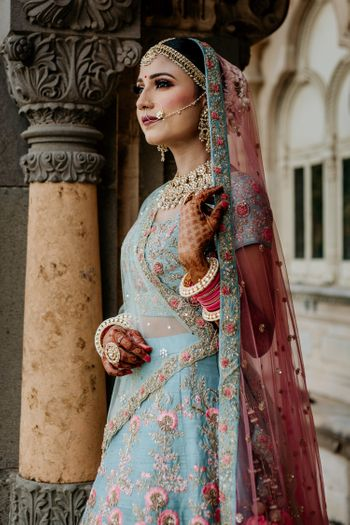 A bride in blue with contrasting pink dupatta