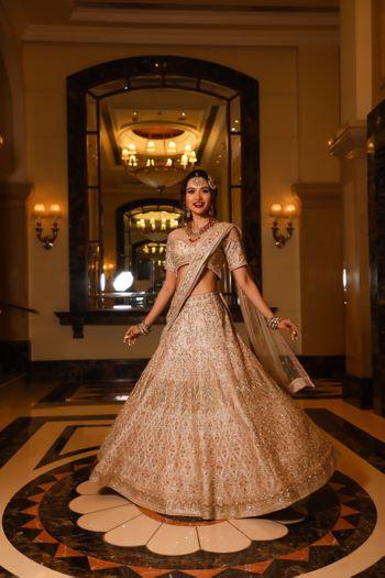 Twirling bride in shimmer lehenga