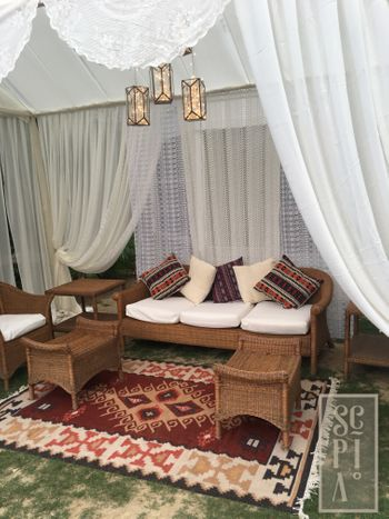 Modern Persian influence decor with rugs and drapes